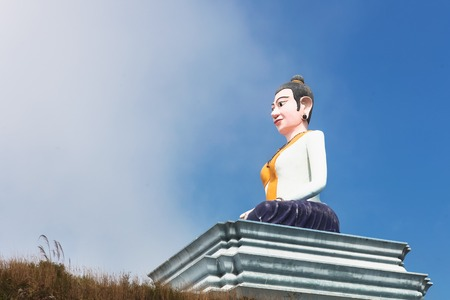 Statue of sitting Buddha in the clouds fog, Cambodia, Bokor Mountains, Kampot province