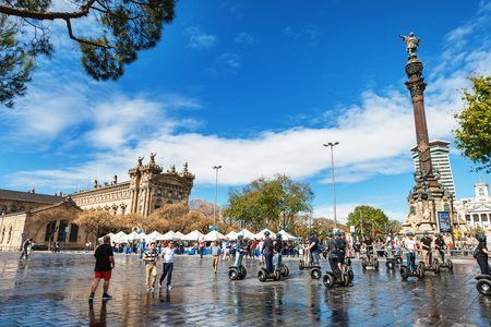 christopher: Barcelona, Spain - April 17, 2016: Statue of Christopher Columbus pointing America, touristst travel by segway