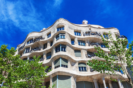 decorative balconies: Barcelona, Spain - April 18, 2016: Facade of Casa Mila (La Pedrera) by Antoni Gaudi in prospect Diagonal, Barcelona, Spain. Editorial