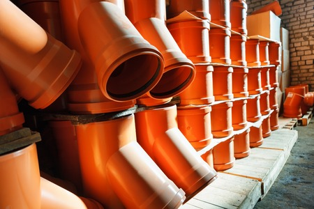 fitting in: PVC fitting in the white warehouse - a draining tee revision orange pipe Stock Photo