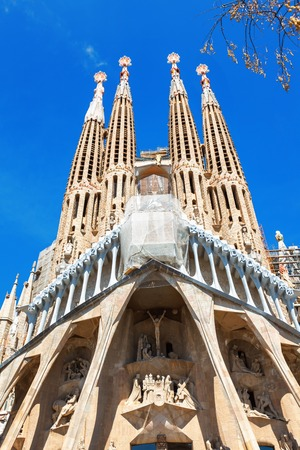 Barcelona, Spain - April 18, 2016: Main facade and details of Cathedral of La Sagrada Familia. It is designed by architect Antonio Gaudi and is being build since 1882. Reklamní fotografie - 63955693