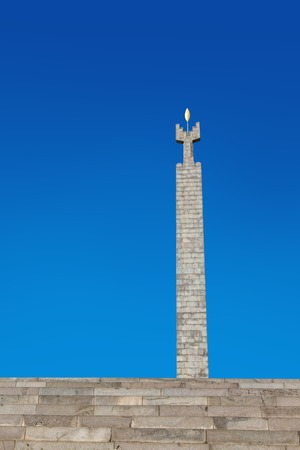 Yerevan, Armenia - September 26, 2016: Monument dedicated to the 50th years Anniversary of Soviet Armenia on top of Cascade Complex, stair and stella with golden leaf