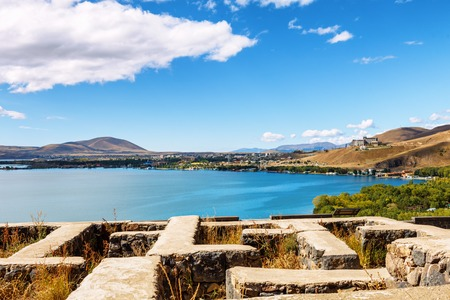 the view on mountains from church ruins at Sevan lake and white clouds on blue sky on a sunny day, Armenia