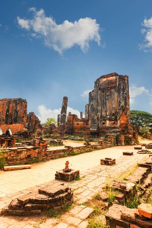 Ruins of Famous temple area Wat Phra Si Sanphet, Former capital of Thailand in Ayutthaya, panoramic view on sunny day