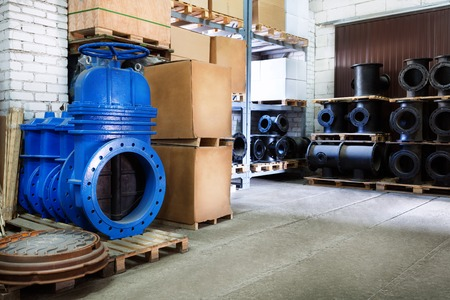 stop gate valve: modern locking devices allow you to safely operate the gas supply . In isolation. On a white background blue metal shut-off valve for gas pipelines. Sliding knife gate valve Shutoff and control valves. boxes. fitting. Warehouse of pipe factory. Sliding kn