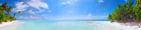 Scenic panorama view of Wild idyllic Beach at Maldives island Fulhadhoo with white sandy beach and sea and curve palm Stock Photo