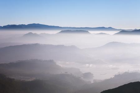 adams: Beautiful landscape. Sunrise on the mountain chain Samanala in the clouds from Sri Pada Adams Peak. Sri Lanka.