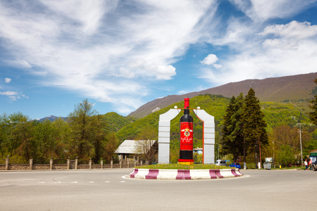 Ambrolauri, Georgia - 28 April 2017: Monument to the bottle of wine Khvanchkara in the center of the city, Racha region, lower Svaneti