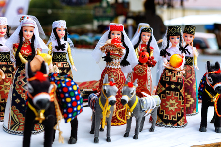 Armenian ancient doll souvenir made from cloth fabric in national costumes sold in the market