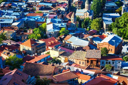 aerial view from the top of cockpit on the roofs of the old city of Tbilisi: houses with traditional wooden carving balconies, famous Georgian architecture of Old Town of Tbilisi, Georgia Banco de Imagens