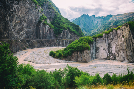 azeri: View of mountains Babadag, road and a muddy river Girdimanchay Lahij yolu from the side in Lahic village, Azerbaijan