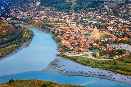 The Top View Of Mtskheta, Georgia, The Old Town Lies At The Confluence Of The Rivers Mtkvari And Aragvi. Svetitskhoveli Cathedral, Ancient Georgian Orthodox Church, Unesco Heritage In The Center.