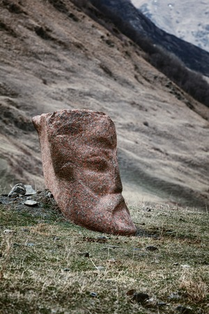 Stone face head of Rustaveli, Chavchavadze, Vazhapshavelo and Kazbegi in Sno valley in Georgia along the military road to Kazbegi