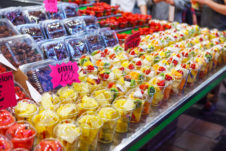 Fruit Salad arranged in plastic cups on a market