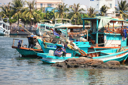 Phu Quoc, Vietnam - 14 January, 2015: Lifestyle of fishermen on their boats in An Thoi pier village, Phu Quoc island, Vietnam