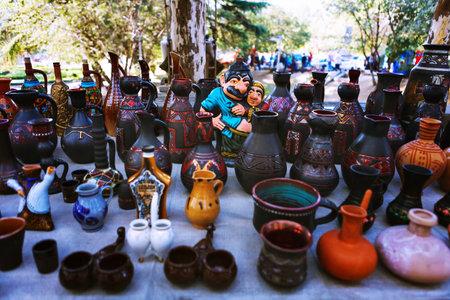 Tbilisi, Georgia - 08 October, 2016: Dry Bridge Flea market in Tbilisi sells tableware set, dishes, souvenir georgian Clay jugs Editorial