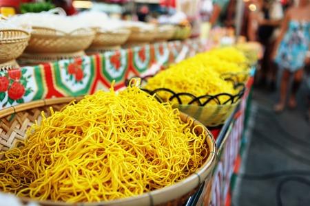 Thai egg yellow noodle on street food Phantip market in Ko Pha Ngan, Thailand. Pad Thai is famous Thai food Stock Photo