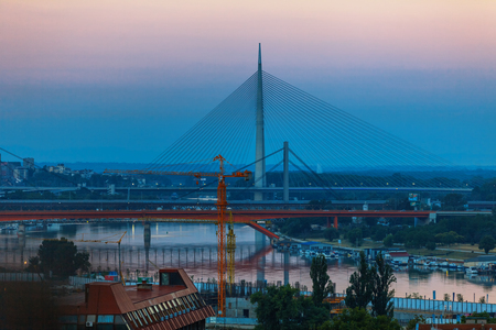 View on Ada Bridge. Belgrade cityscape from the Sava river in Serbia in a beautiful summer day, close to Belgrade fortress
