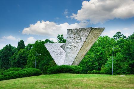 Broken wing or Interrupted Flight monument in Sumarice Memorial Park near Kragujevac in Serbia on a summer day Stock Photo