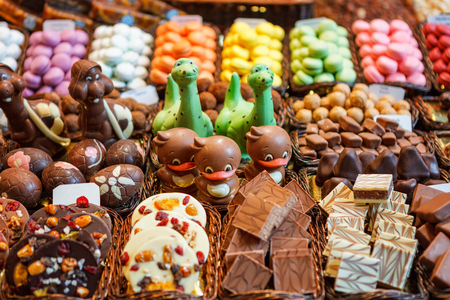 Confectionery at Boqueria market place in Barcelona, Spain. Assorted chocolate candy shop. Stall of colorful sweets