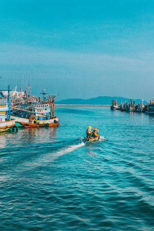Chumphon, Thailand - 9 February 2014: Fishing boats at the coastal fishing villages. Preparation sea fishing. Sailing by Chumphon river. entering the sea along the pier