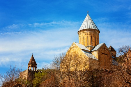 Nice panoramic view of the church Ananuri, standing on the shore of the reservoir Zhinvali. Georgia on a sunny day