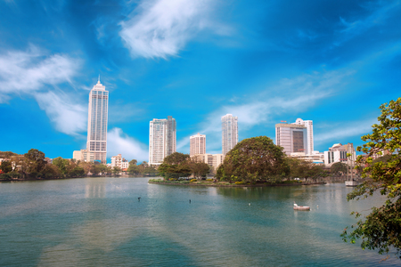Colombo, Sri Lanka - 11 February 2017: Panorama with reflection of Beira Lake and business district, towers skyscrapers in Colombo, Sri Lanka Editorial