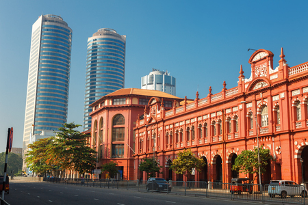 Colombo, Sri Lanka - 11 February 2017: Panoramic view cityscape of The red building of Cargills and Miller in York Street with the skyscrapers towers of World Trade center, colonial architecture Editorial
