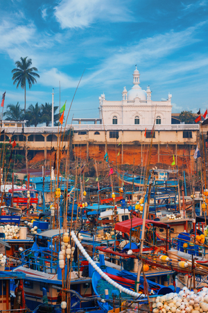 Beruwala, Sri Lanka - 10 February, 2017: Fishing boats stand in Beruwala Harbour fish market in Bentota or Aluthgama area. One of the biggest Srilankan fresh seafood markets. View on Ketchimale Mosque