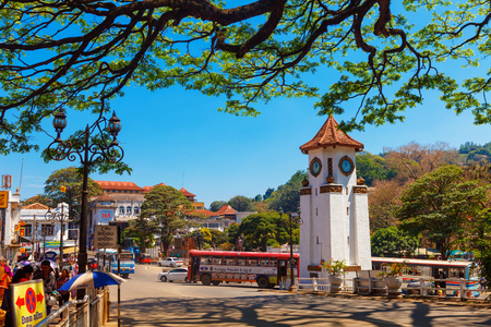 Kandy, Sri Lanka - February 5, 2017: City traffic, Clock tower Roundabout and police station in downtown Kandy, close to temple of Tooth Buddha Dalada Maligawa