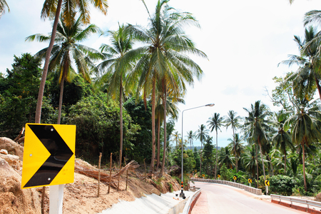 Curved Asphalt roads in the jungle forest and turn left in Koh Pha Ngan, Thailand