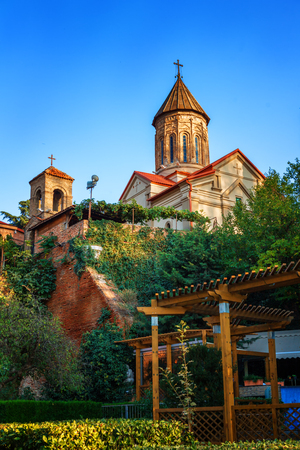 he Ejmiatsin or Nor Echmiadzin Church of Armenian Apostolic church, surrounded by sypresses, located in Avlabari District, Tbilisi, Georgia Stock Photo