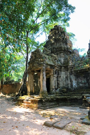 Entrance to ancient Preah Khan temple in amazing Angkor, Siem Reap, Cambodia. Mysterious Preah Khan nestled among rainforest. Blue sky in background. Enigmatic Angkor is a popular tourist attraction. Stock Photo