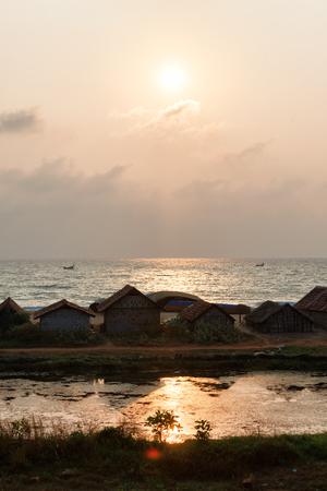Sunset over the backwaters in Kerala, India, near Varkala, Odayam beach, fishermen village