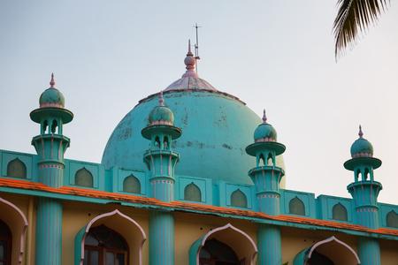 Odayam Juma Masjid Blue and coral color Muslim Mosque at Varkala Odayam beach, Kerala, India Stock Photo