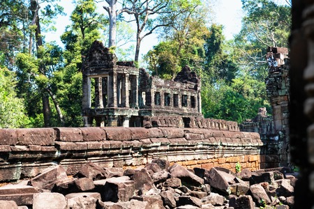Ruins of ancient Preah Khan temple in amazing Angkor, Siem Reap, Cambodia. Mysterious Preah Khan nestled among rainforest. Blue sky in background. Enigmatic Angkor is a popular tourist attraction.