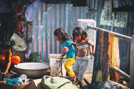 Sihanoukville, Cambodia - January 18, 2015: Cambodian kids play in slum village near Otres Beach in Sihanoukville, Cambodia Redakční