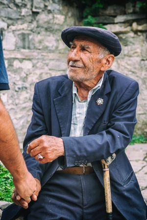 Lahic, Azerbaijan - July 18, 2015: Portrait of Blind tanner in Lahic, making belts for the saddle