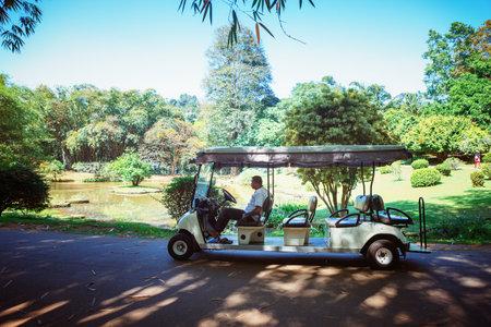 Kandy, Sri Lanka - 5 February 2017: Elctrocar cart for tourists in Royal Botanical King Gardens, Peradeniya, Sri Lanka, locates near Kandy Editorial