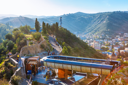 Tbilisi, Georgia - October 05, 2016: funicular station, aerial view from the top of cockpit on the roofs of the old city of Tbilisi: houses with traditional wooden carving balconies, famous Georgian architecture of Old Town of Tbilisi, Georgia Banco de Imagens - 93105737