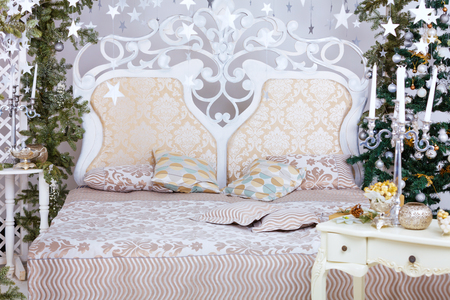 Winter holidays decorated bedroom interior. Christmas and New Year mood stars end tree