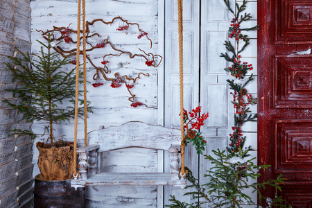 Christmas and New Year Decoration studio Over white Wooden Background vintage loft style. giftboxes, candles, fir tree, red door, lantern