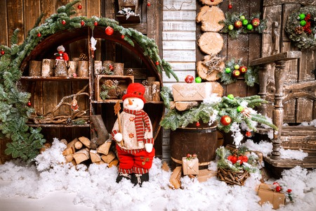 Christmas Decoration Over Wooden Background. Decorations over Wood, snowman, candles, giftboxes Vintage Reklamní fotografie