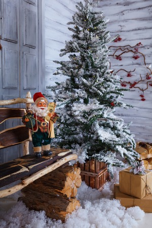 Christmas and New Year Decoration studio Over white Wooden Background vintage loft style. giftboxes, candles, fir tree, red door, santa claus, lantern