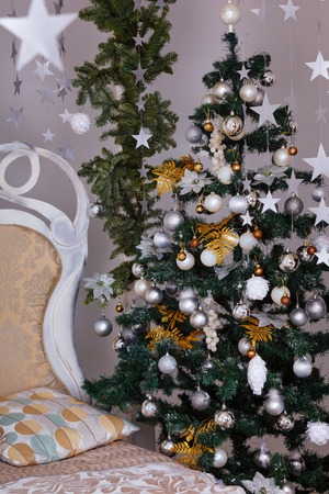 Winter holidays decorated bedroom interior. Christmas and New Year mood stars end tree, white colors, classic style, golden candles Reklamní fotografie