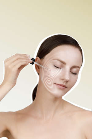 Female applying anti wrinkle serum on face, eyes closed, brown low ponytail, studio beauty shot, light yellow isolated background, graphic massage lines visualize effect of skin care product
