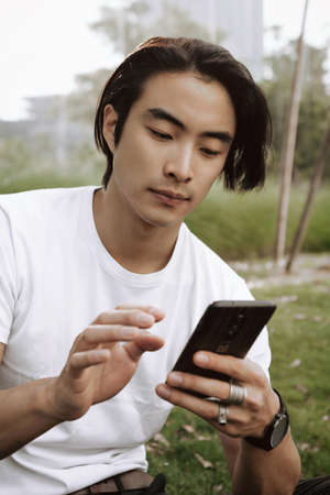 man using smartphone, holding in hands and surfing the phone, phone application concept, internet banking