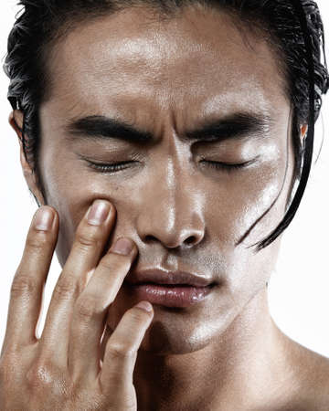 Asian Chinese Korean male model portrait shot in studio, crispy and sharp wet skin and hair, fashion hi-end beauty magazine style concept, eyes closed