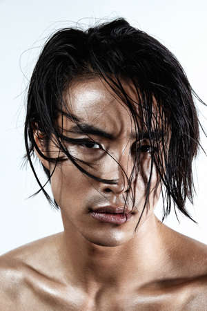 Asian Chinese Korean male model portrait shot in studio, crispy and sharp wet skin and hair, fashion hi-end beauty magazine style concept, looking in camera