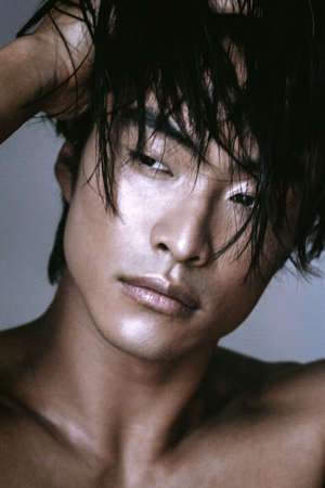 Asian Chinese Korean male model portrait shot in studio, crispy and sharp wet skin and hair, fashion hi-end beauty magazine style concept, looks away